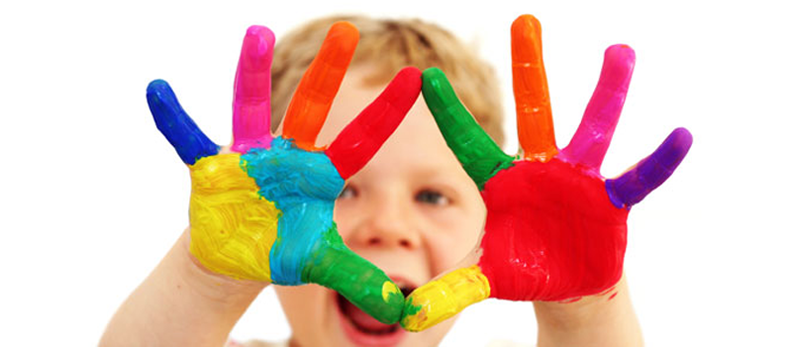 Child with hands painted for child play therapy at the Swan Family Support and Drug Rehabilitation Centre